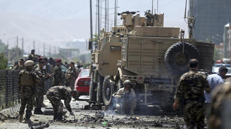 Afghanistan's security forces search the site of a suicide attack in Kabul, Afghanistan, Sunday, Aug. 10, 2014.